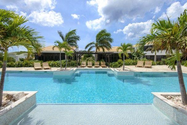Appartementen villas met zwembad aan golfbaan dichtbij strand re max abc curacao - Zwembad met strand ...